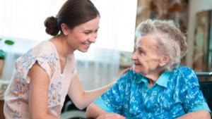 CNA helping a senior woman
